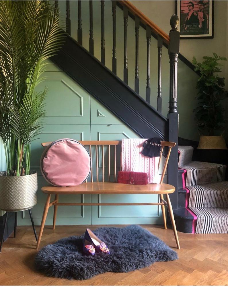 hallway painted in railing farrow & ball bench seat velvet cushion sheepskin rug herringbone floor