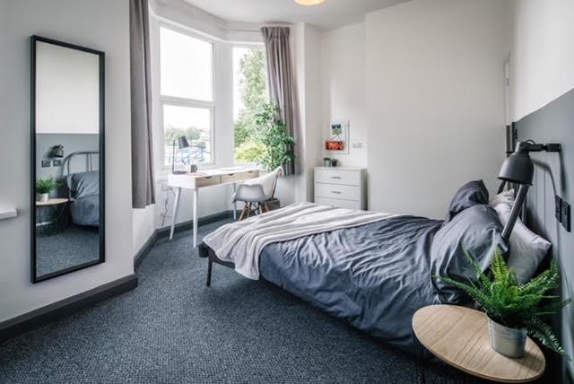 grey and white bedroom bay window scandi style desk