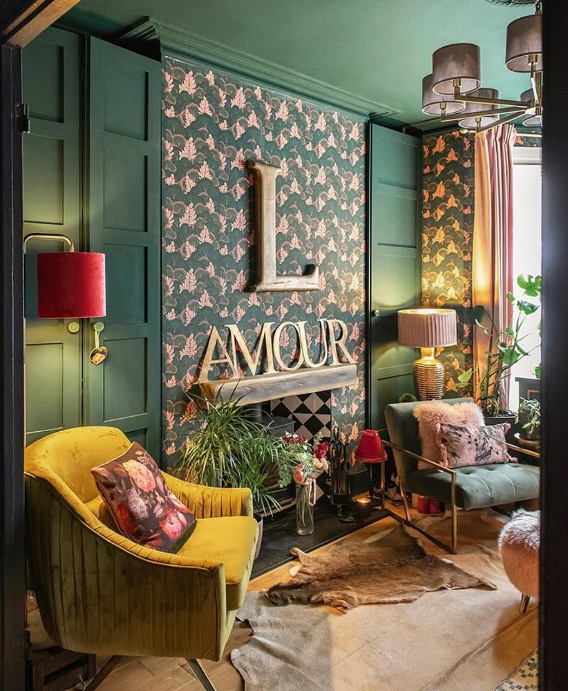 victorian living room dark green and pink decor log burner yellow velvet chair bold wallpaper