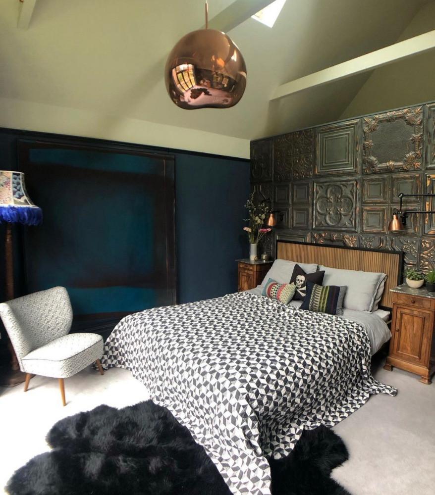 brooklyn tile wall, dark decor, geometric throw, sheekskin rug, pirate cushion, copper pendant light