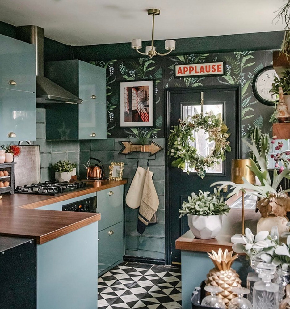 dark green high gloss kitchen black and white floor patterned wallpaper plants small kitchen ideas