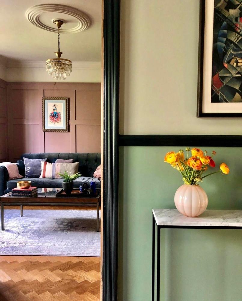 green hallway pink sitting room chandelier parquet floor