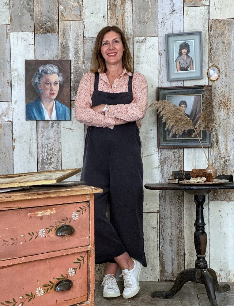 karen barlow the old potato store coral pink vintage drawers antique portraits wood paneled wall