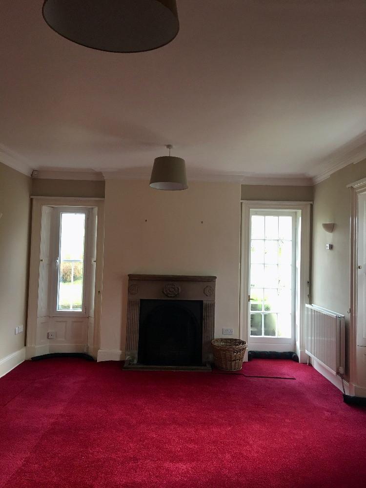 empty room red carpet sitting room living room
