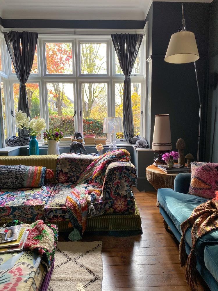 dark grey sitting room powder blur velvet sofa floral sofa wooden floors large windows