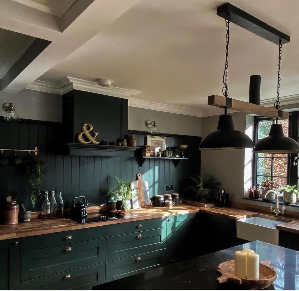 studio green kitchen farro & ball quartz island hanging vintage lamps wood panelling oak worktops