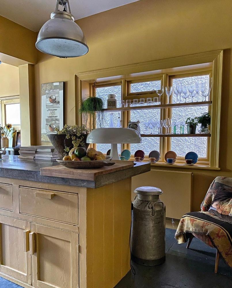 yellow kitchen cabinets vintage kitchen milk churn windows shelves