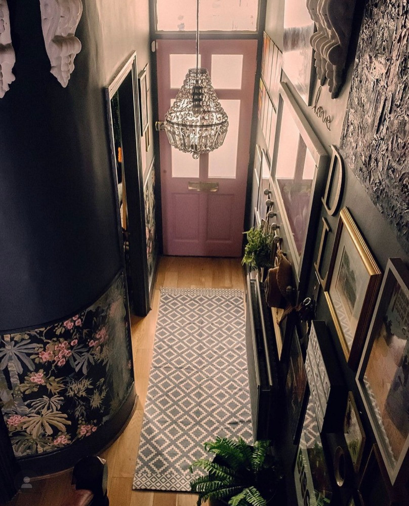 dark eclectic decor hallway gallery wall bold wallpaper interior inspirtion