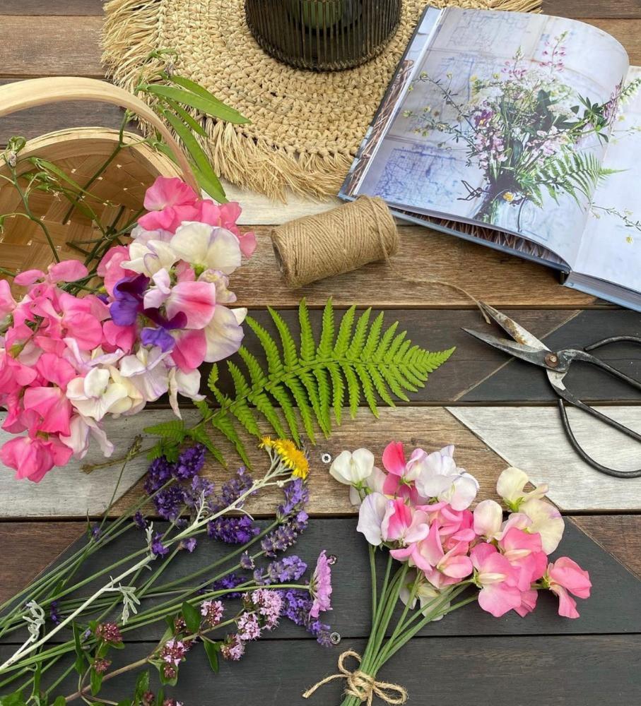 garden flowers flat lay sweet peas ferns statis