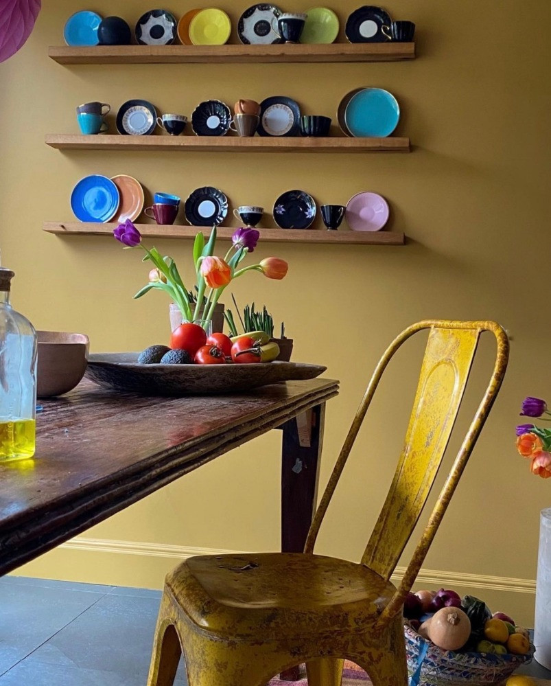 yellow kitchen vintage french metal chair colourful crockery colour pops