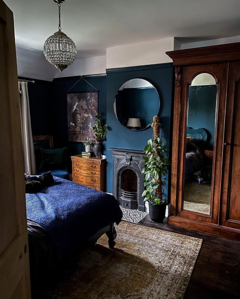 dark blue bedroom decor fireplace period furniture preloved chandelier