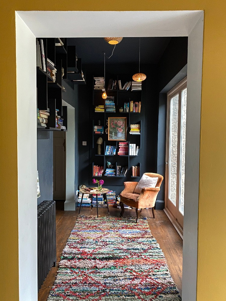 long view through hallway to reading nook dark decor interiors inpiration