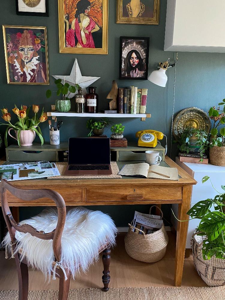 home office study area dark green gallery wall vintage desk sheepskin on chair retro telephone
