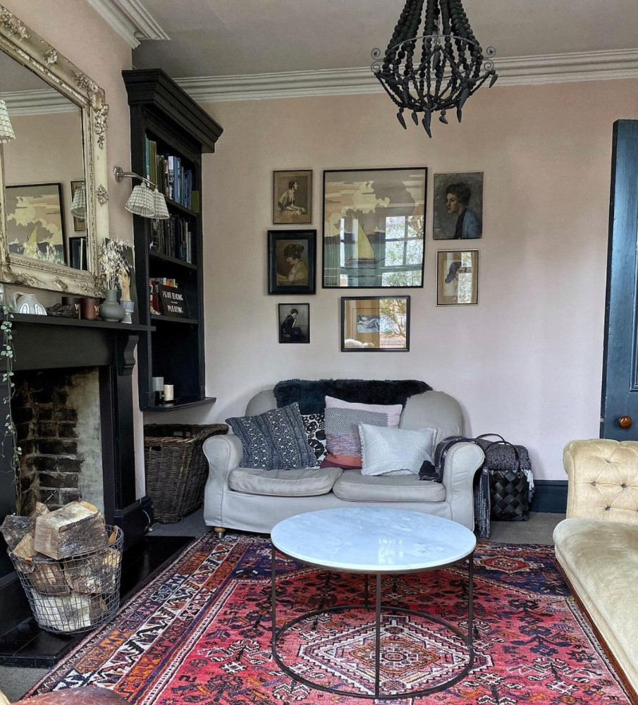 pale pink sitting room black chandelier red vintage rug fireplace Victorian country house style