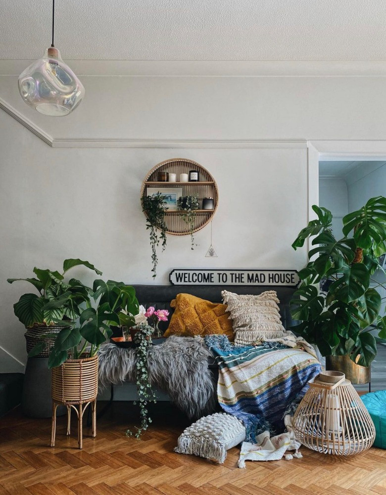 hallway styled with plants herringbone floor