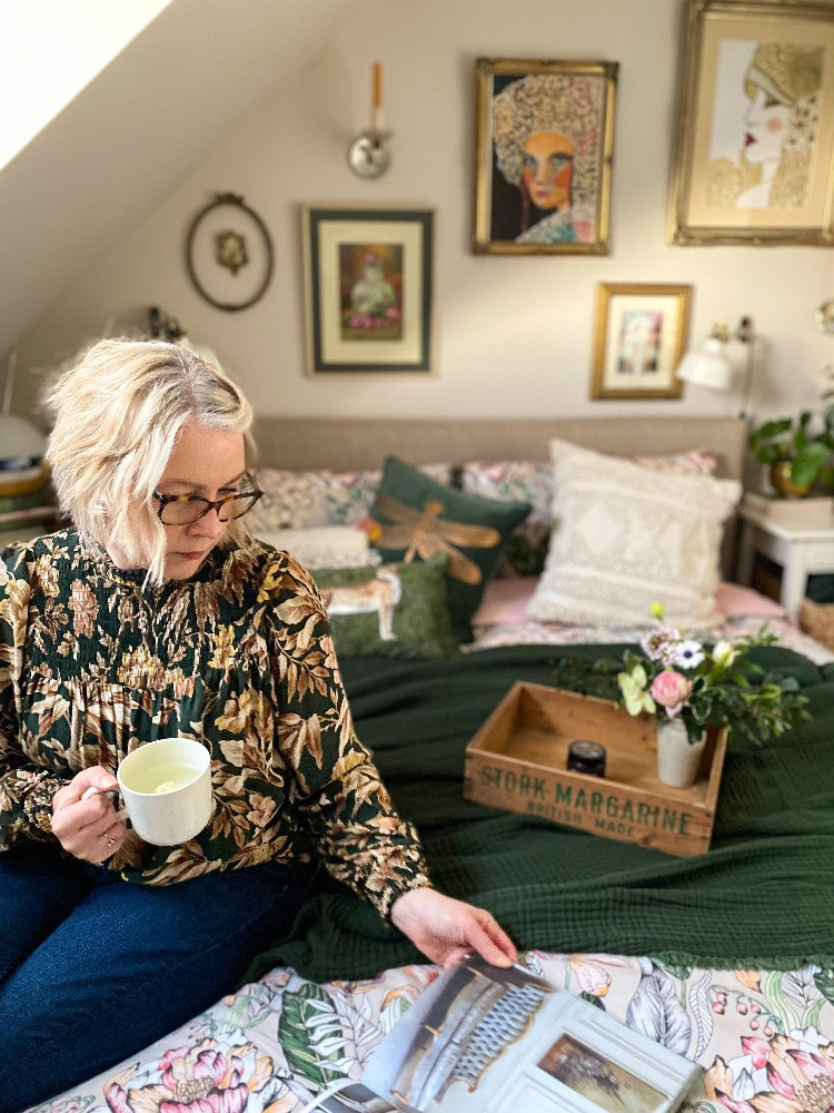 SArah Twigg Doyle green bedroom reading a magazine