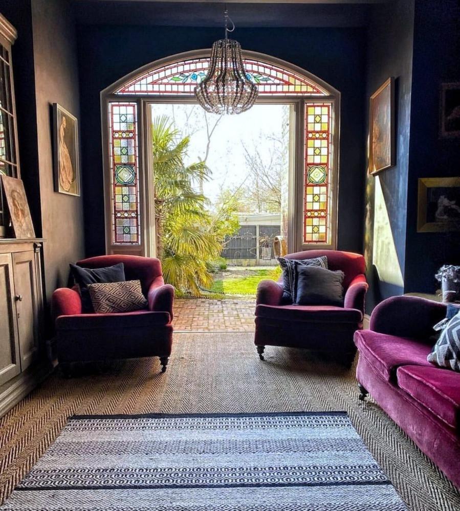 dark decor stained glass reclaimed doors french chandelier garden room