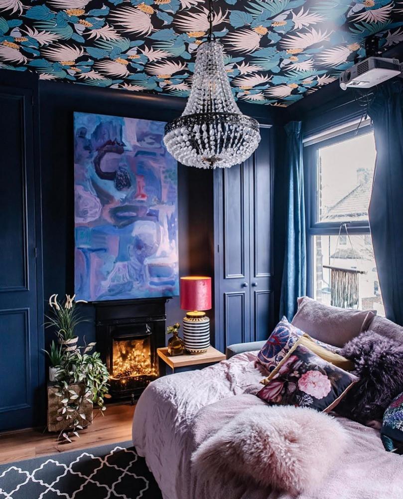 dark blue bedroom wallpapered ceiling chandelier abstract art