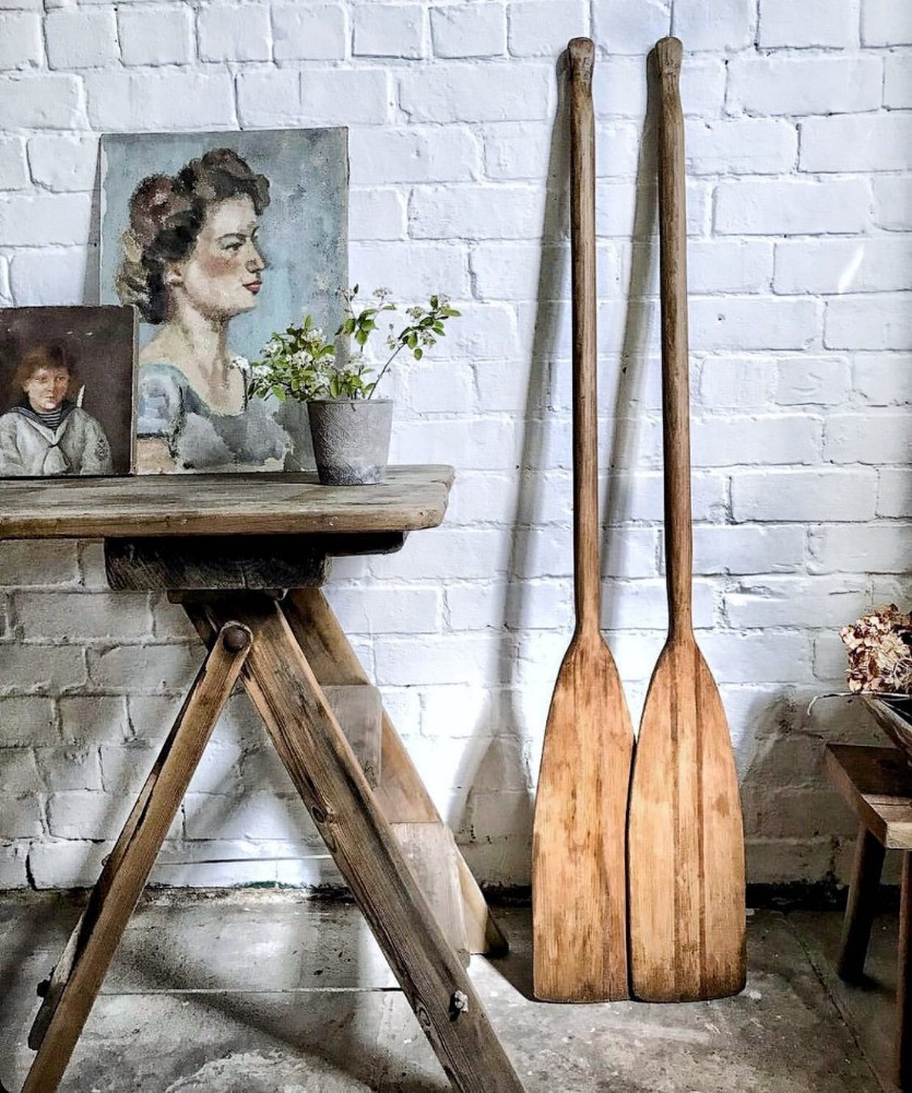 the old potato store vintage seller white washed wall vintage rowing oars antique oil paintings vintage aesthetic