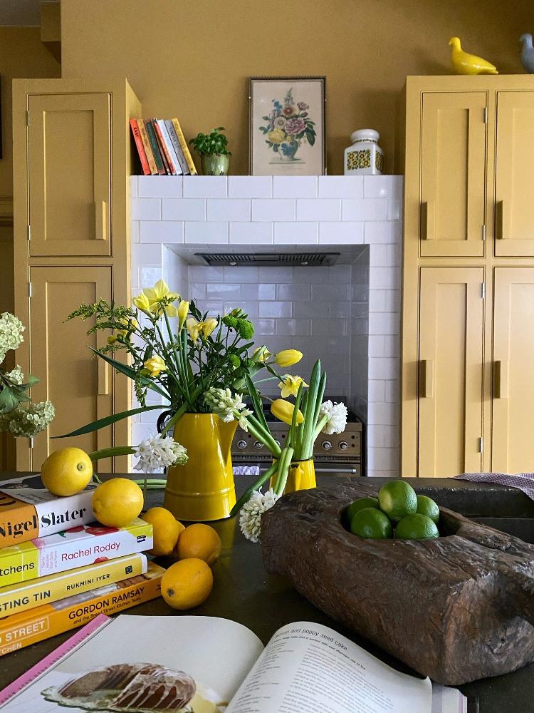 yellow kitchen cookbook lemon on countertop tulips