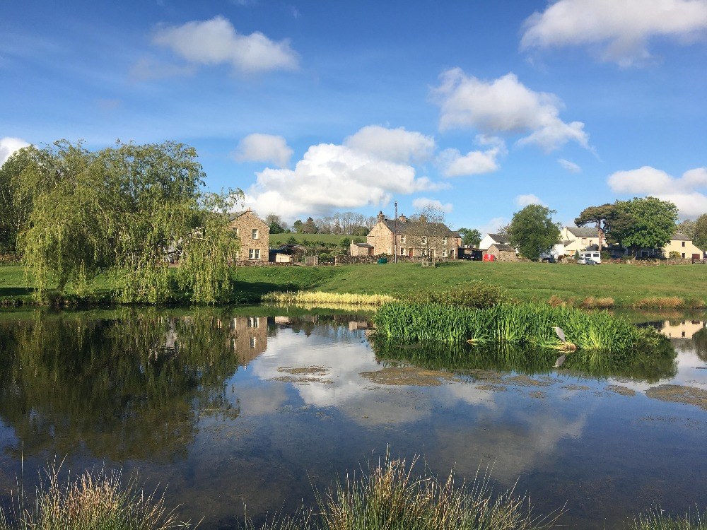 Caldbeck village green duck pond lake district northern fells cumbria