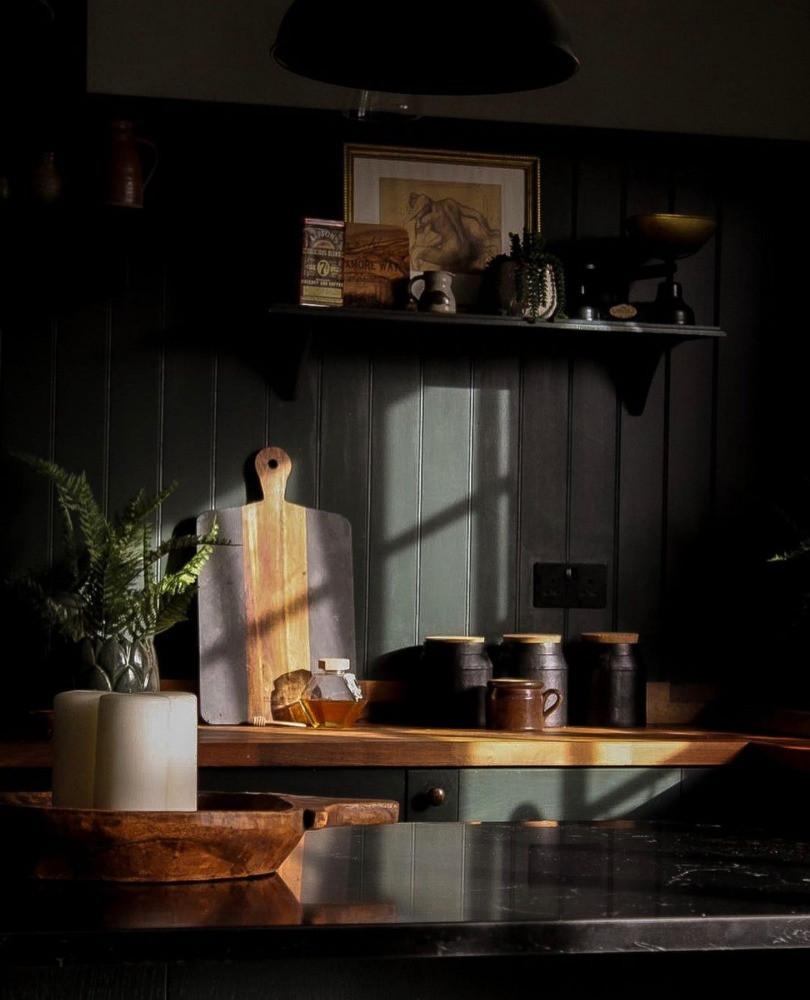 dappled light in dark kitchen natural materials shadows cast opening shelving shelfie interiors inspiration