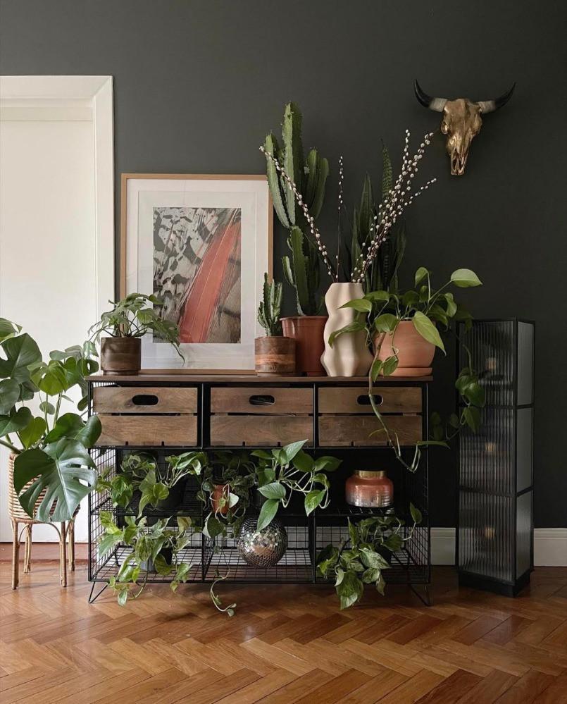 dark decor styling house plants industrial sideboard artwork