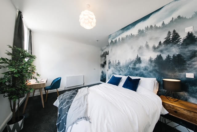 student accommodation designed for wellbeing biophilia forest mural plants