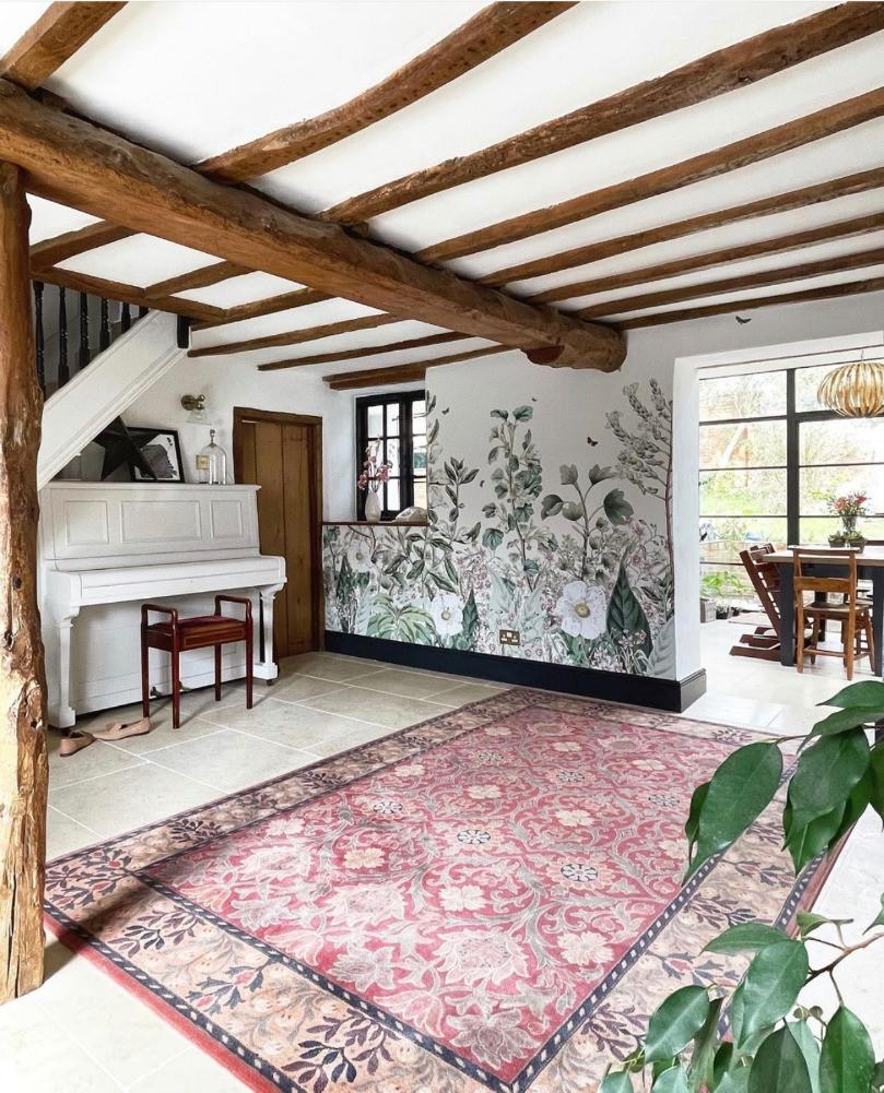 beamed listed cottage hallway botanical mural vintage persian carpet