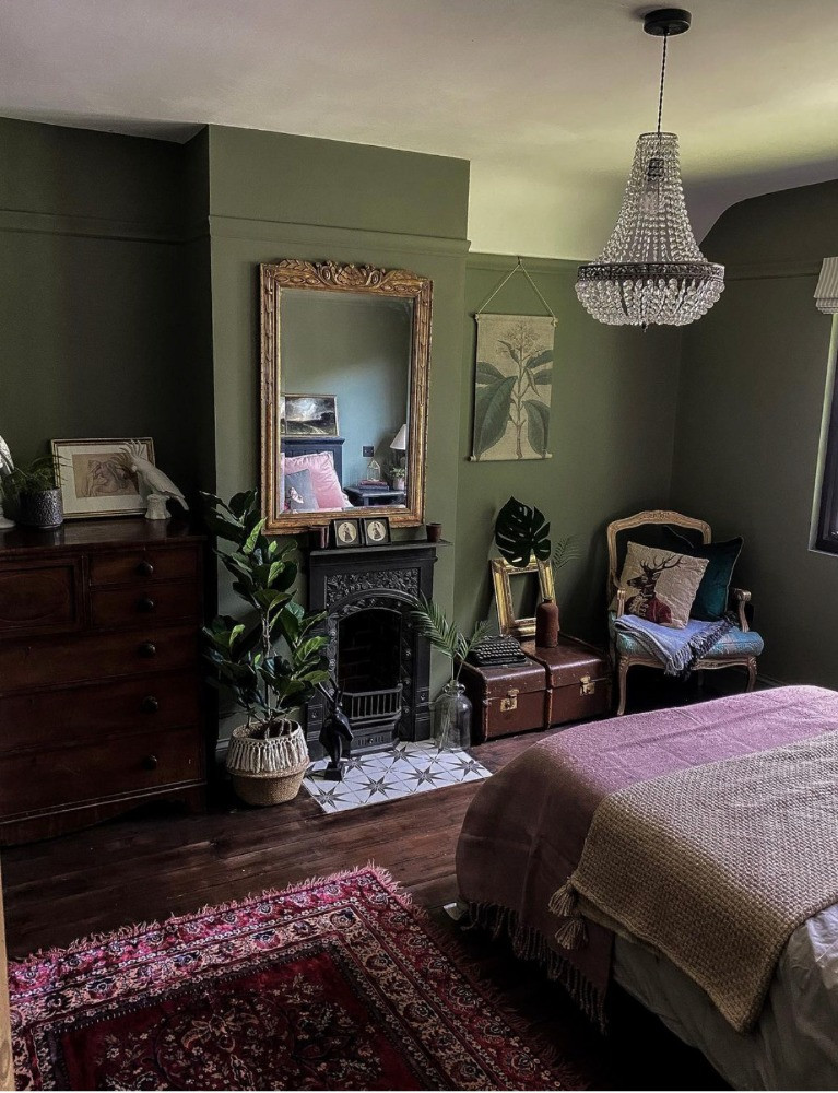 green bedroom dark decor chandelier vintage rug period fireplace