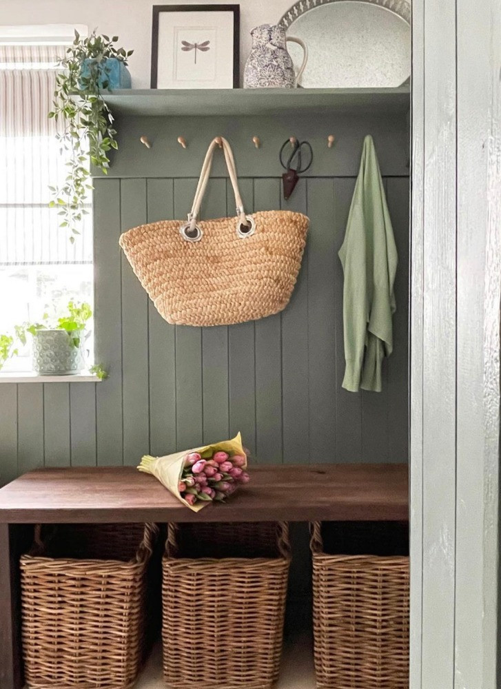 green wood panelled boot room tulips basket