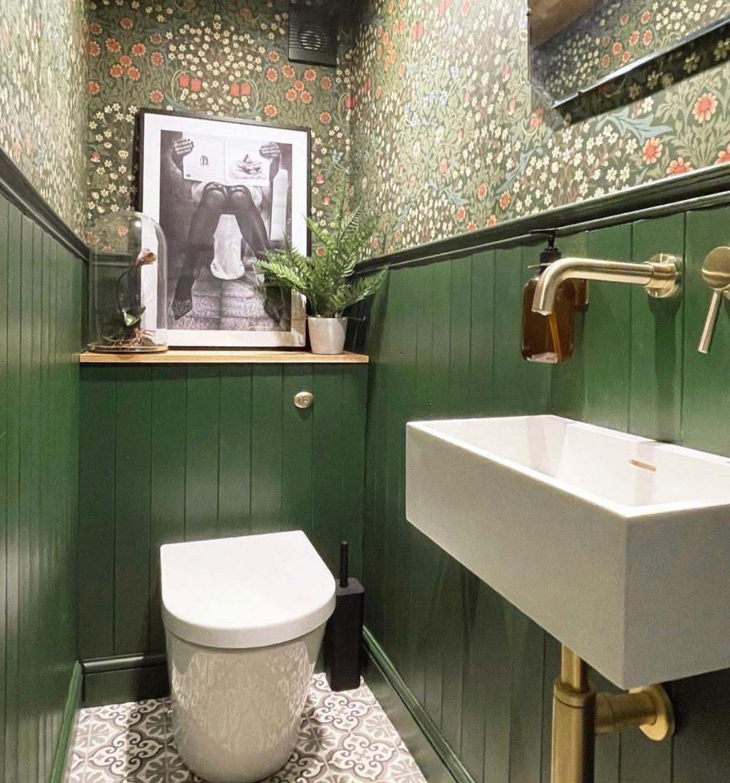 dark green cloakroom william morris wallpaper wood panelling gold taps
