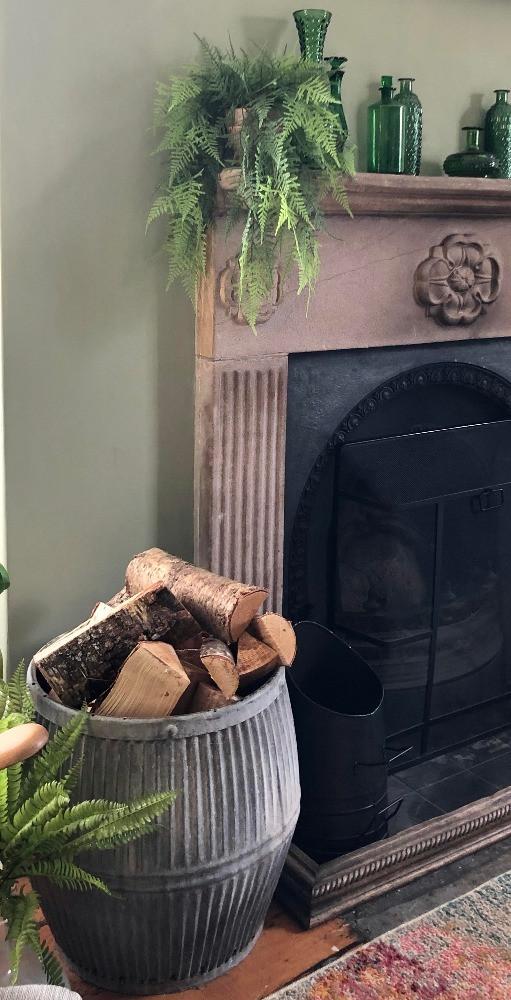 vintage dolly tub log basket fireplace green walls