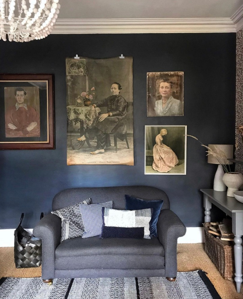 dark blue sitting room antique vintage oil paintings faded Victorian interiors style