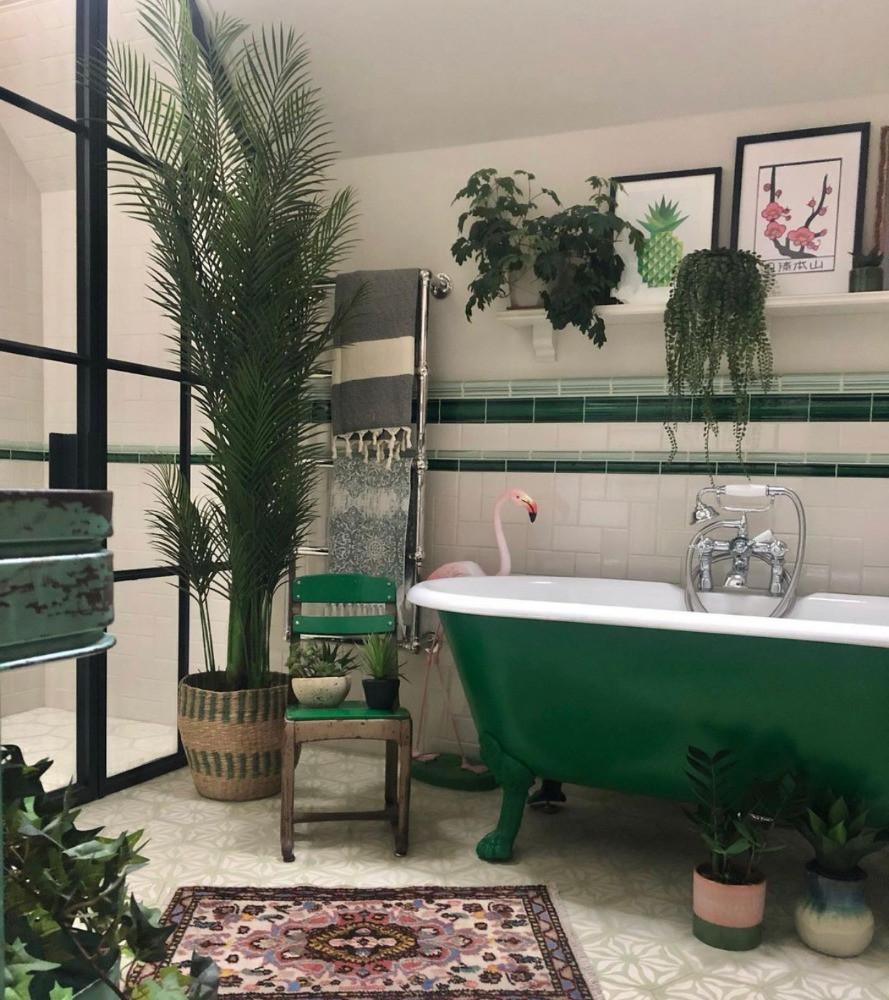 green bathroom crttal doors plants flamingo