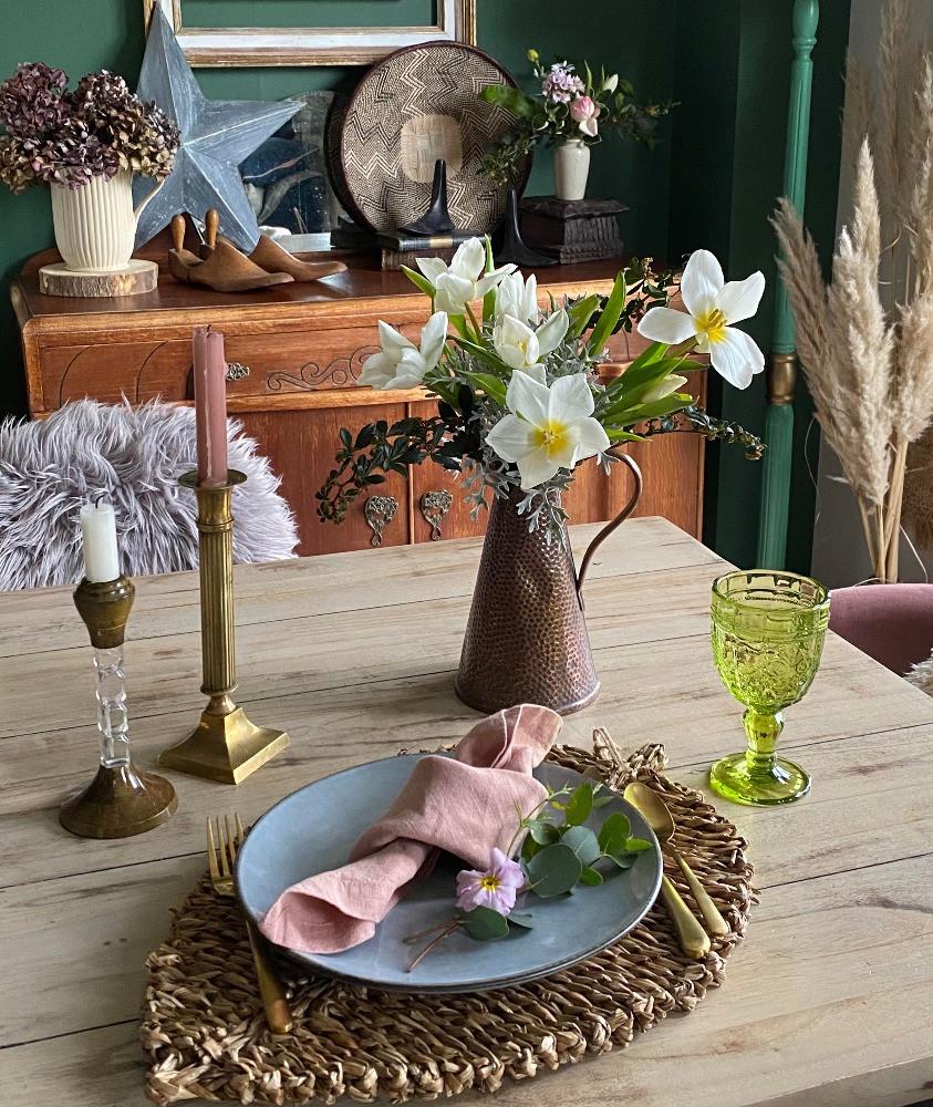 table setting vignette candlesticks flowers in vase sideboard