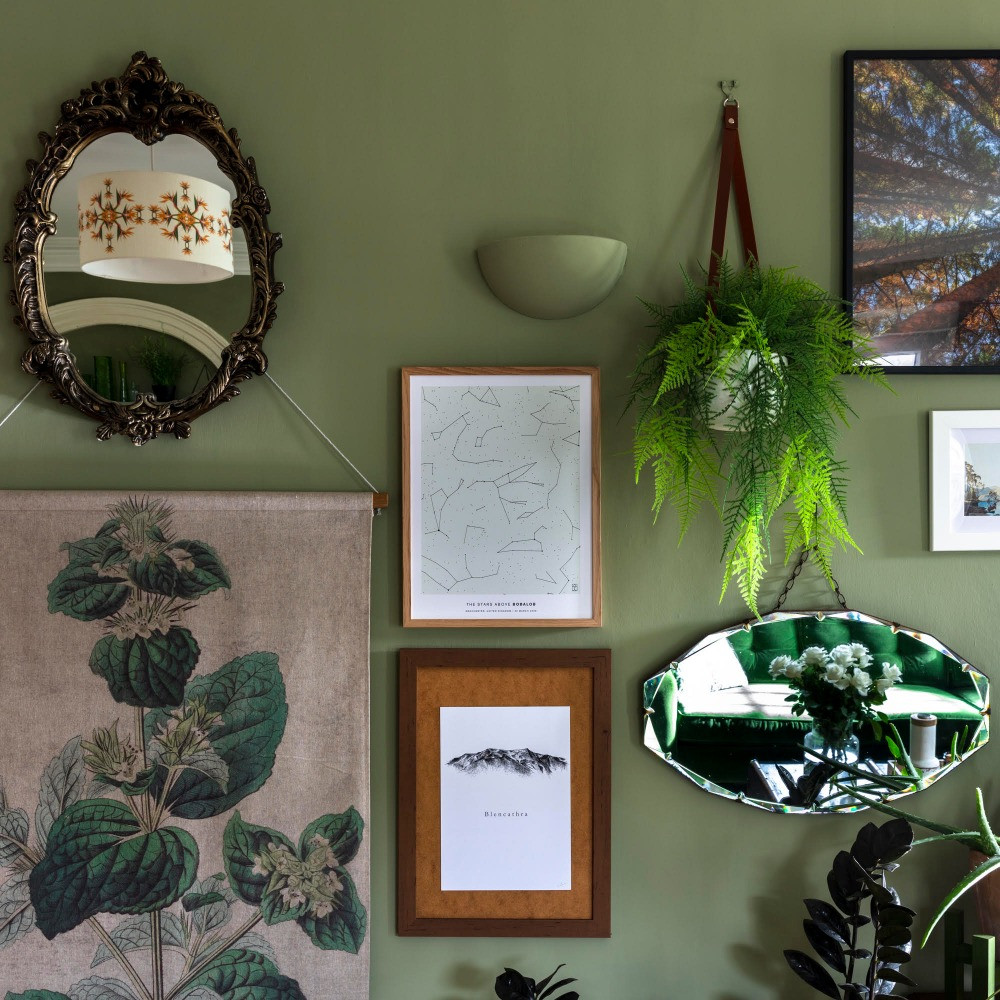 green gallery wall nature inspired artwork botanical prints plants vintage mirrors