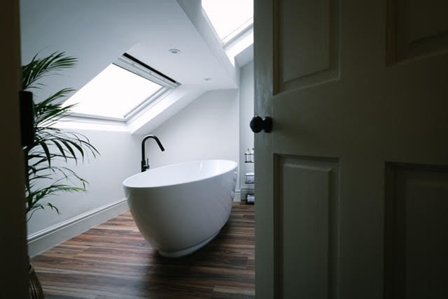 contemporary free standing white bath black tap