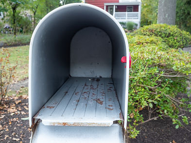 empty mailbox in front of suburban house.jpg