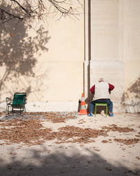 Along the Siene, a man, a cone, and two chairs