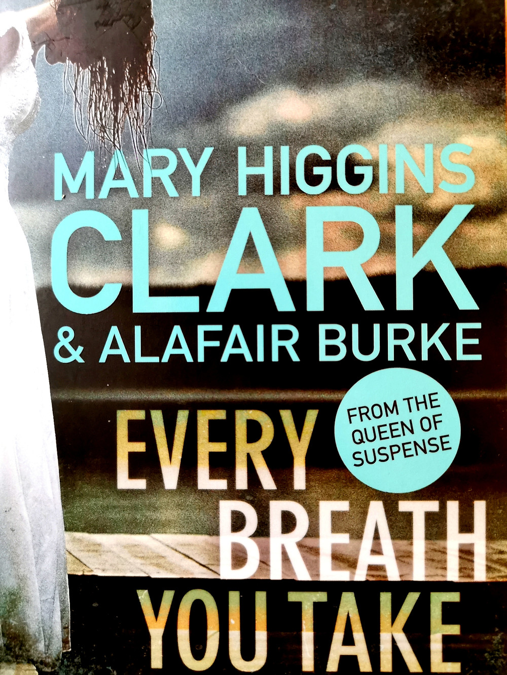 Cover image of Mary Higgins Clarke and Alafair Burke's Every Breath You Take' with a drenched woman in a white dress leaning over the edge