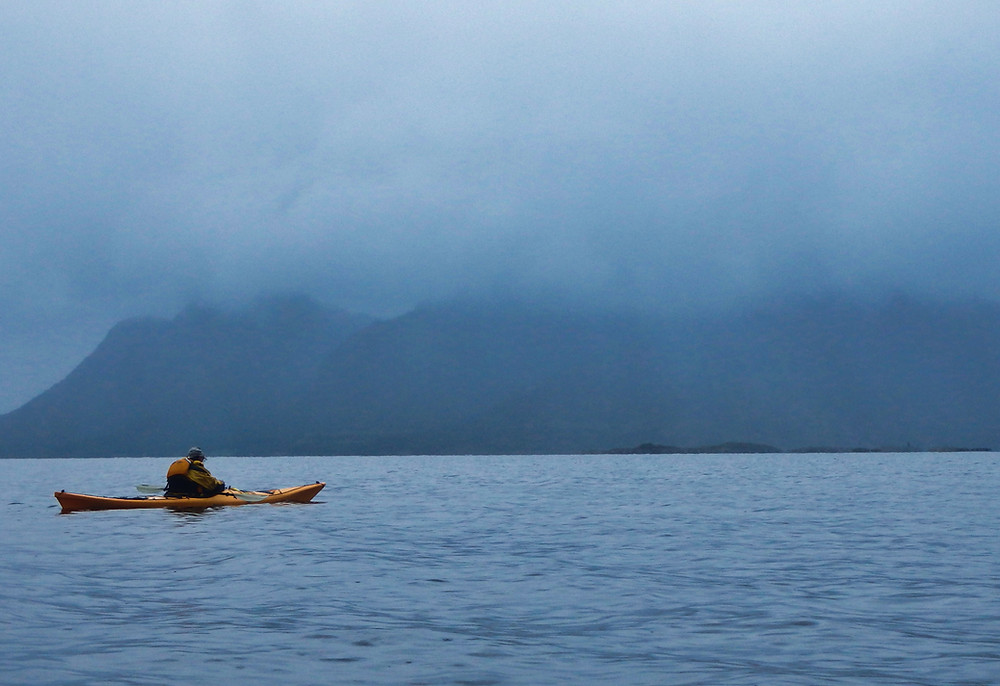 Sea kayaking under the misty mountains