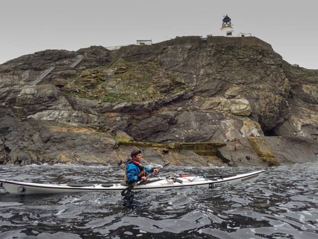 Paddling under the Muckle Fluga lighthouse