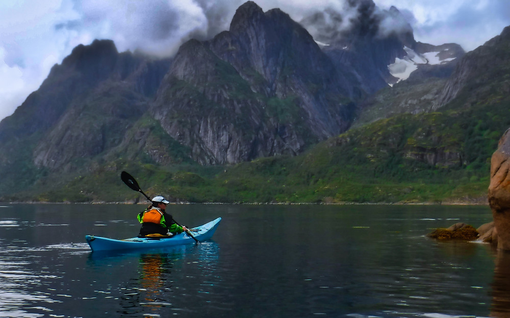 Sea Kayaking under mountains and glaciers