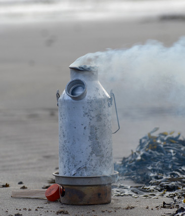 Kelly Kettle boiling hot water for coffee on a beach