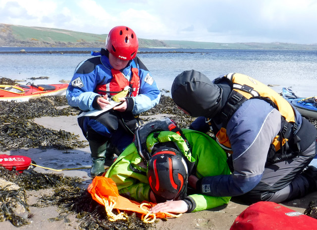 Primary survey and vital signs recording on the beach