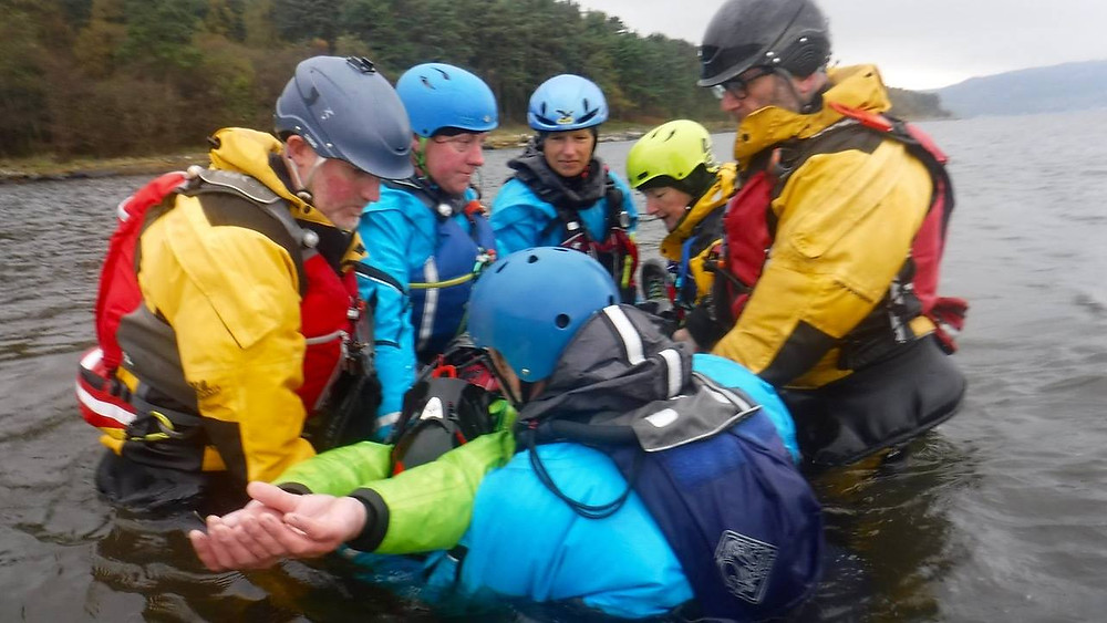 Managing a possible spinal injury in the sea