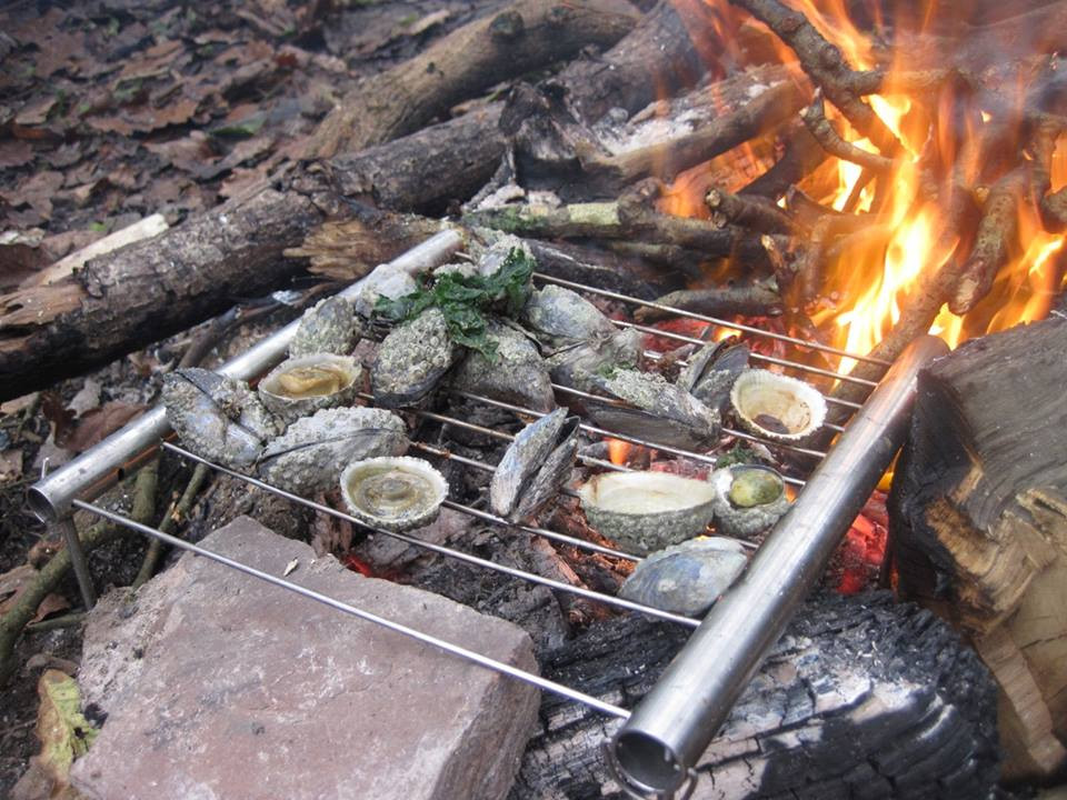 Foraged sea food goodies cooking on an open fire