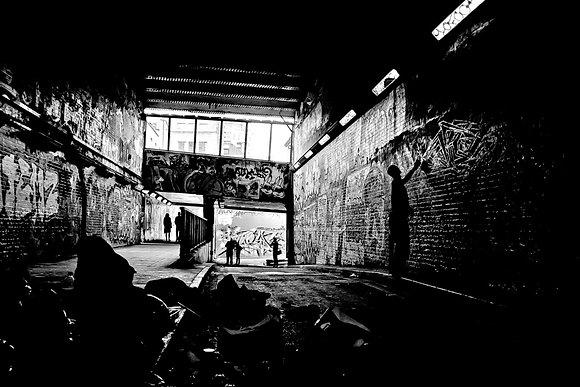 Artist at work - 'Banksy' graffiti tunnel