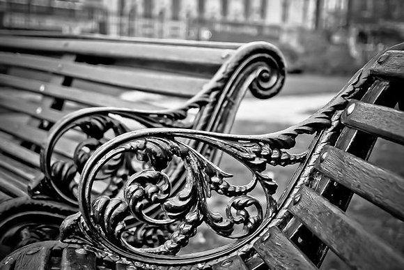 Ornate cast iron park bench - Brixton